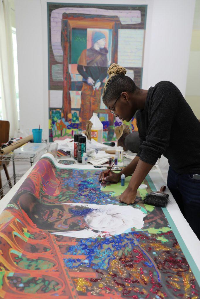 Amani Lewis in the studio. Photo: Albert Grant.