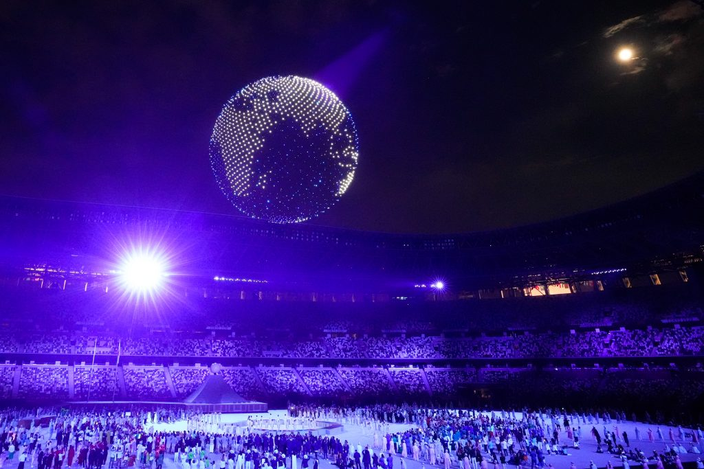 Drones fly to form an image of the Earth over the top of the stadium during the Opening Ceremony of the Tokyo 2020 Olympic Games at Olympic Stadium. Photo by Wei Zheng/CHINASPORTS/VCG via Getty Images.