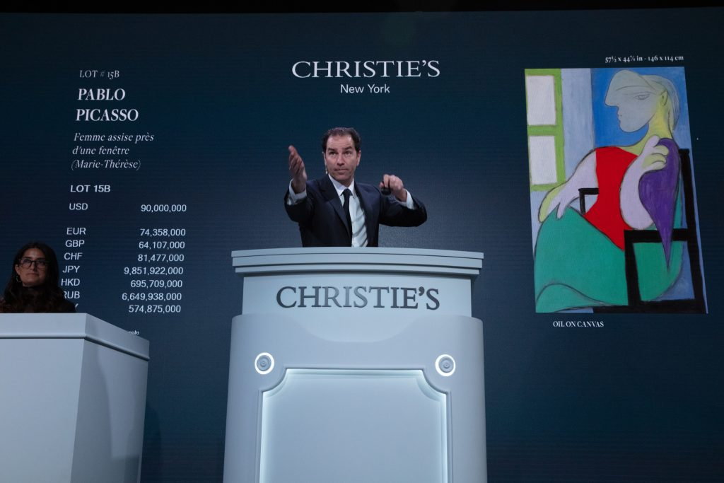 Auctioneer Adrien Meyer fields bids during Christie's 20th Century evening sale in New York in May 2021. Photo: Christie's Images Ltd. 2021.