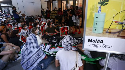 Activists rally at the Museum of Modern Art. (Photo by Lev Radin/Pacific Press/LightRocket via Getty Images)