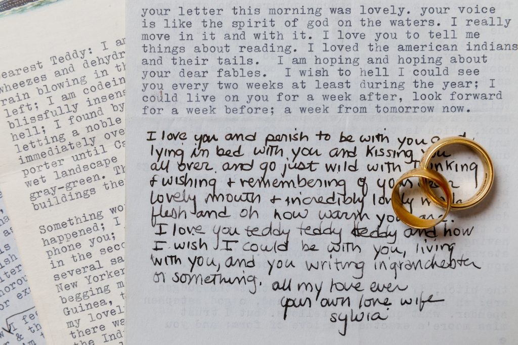 Letters to Ted Hughes from Sylvia Plath, photographed with the couple's wedding rings. Courtesy of Sotheby's.