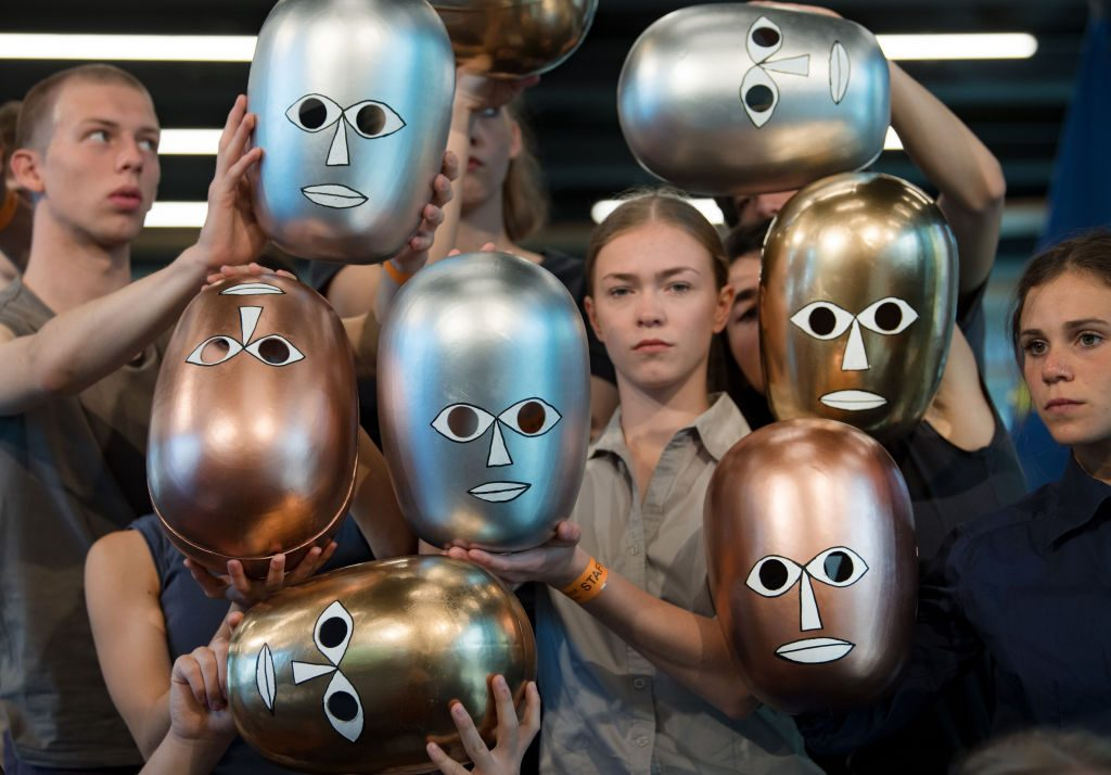 Students dance to the opening of the Bauhaus Museum Dessau with stage masks, which go back to Oskar Schlemmer and the Bauhaus. Photo by Hendrik Schmidt/picture alliance via Getty Images.