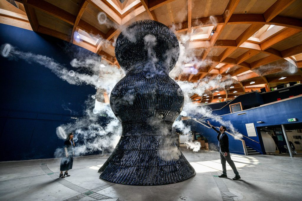 Smoke rings emerge from a sculpture by Studio Swine as it is unveiled at the Eden Project in Bodelva, Cornwall. (Photo by Ben Birchall/PA Images via Getty Images)