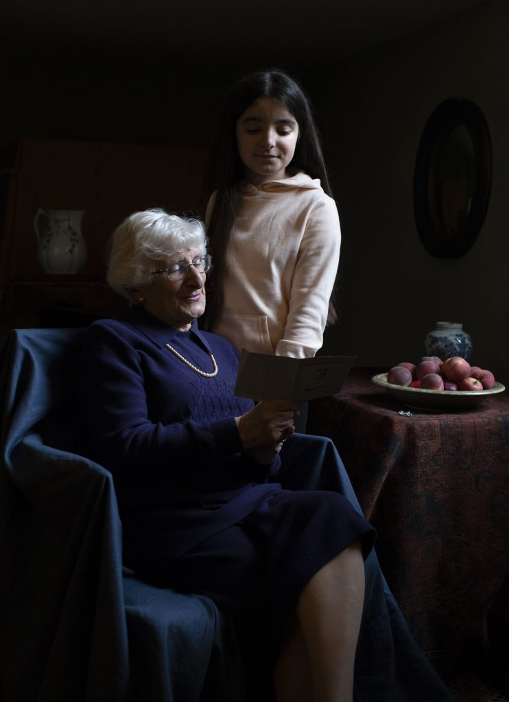 """Kate Middleton, portrait of Holocaust survivor Yvonne Bernstein and her granddaughter Chloe Wright at Kensington Palace for """"Generations: Portraits of Holocaust Survivors"""" at the Imperial War Museums, London. Photo ©the Duchess of Cambridge. Steven Frank"""