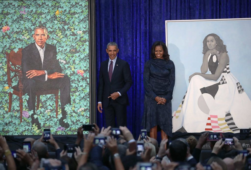 Former U.S. President Barack Obama and former first lady Michelle Obama stand next to their unveiled portraits at the Smithsonian's National Portrait Gallery. Photo by Mark Wilson/Getty Images.