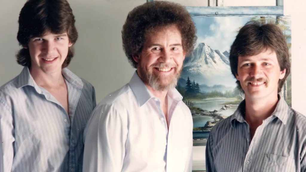 Left to Right: Steve Ross, Bob Ross, and Dana Jester in <em>Bob Ross: Happy Accidents, Betrayal & Greed</em>. Courtesy of Netflix © 2021.