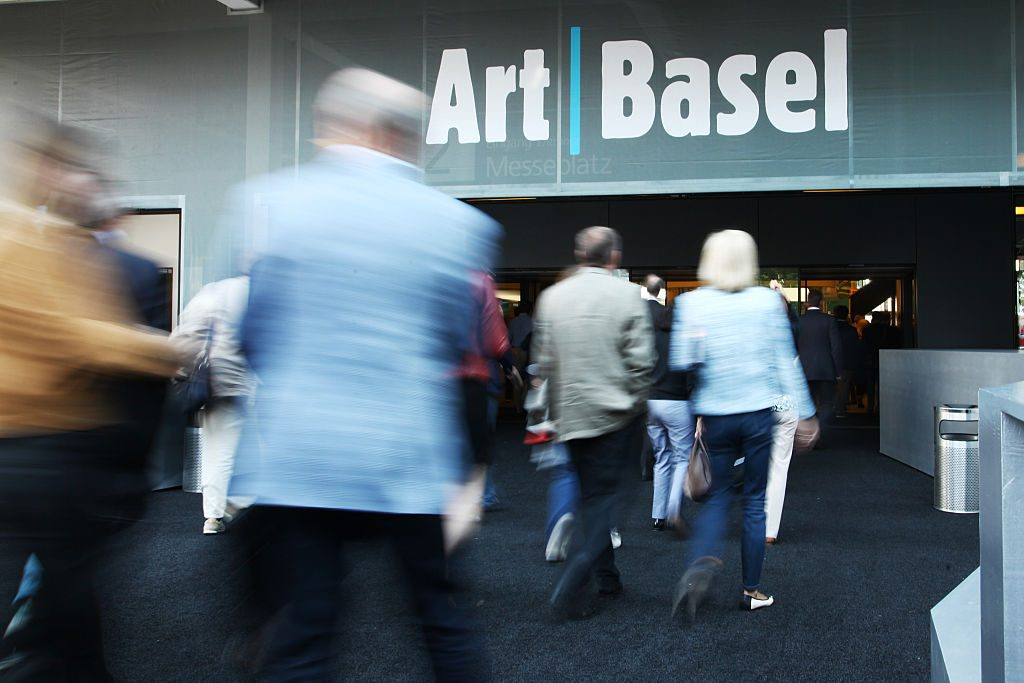 Visitors enter the expositions building during the VIP opening day at Art Basel. Photo by Michele Tantussi/Getty Images.