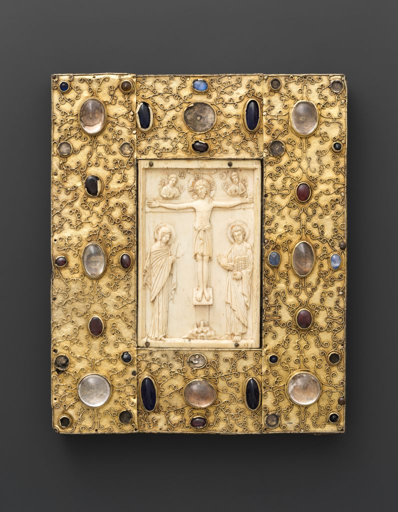 Book Cover with Byzantine Icon of the Crucifixion. Constantinople ivory dates to 1000, late 11th century Spanish setting of silver-gilt with pseudo-filigree, glass, crystal, and sapphire cabochons. Photo courtesy of the Metropolitan Museum of Art, New York,