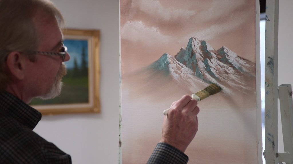 Steve Ross show painting in <em>Bob Ross: Happy Accidents, Betrayal & Greed</em>. Courtesy of Netflix © 2021.