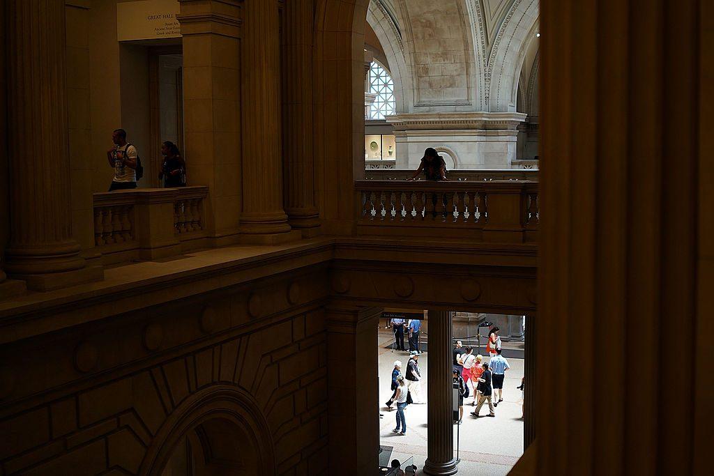 People walk through galleries at the Metropolitan Museum of Art. (Photo by Spencer Platt/Getty Images)