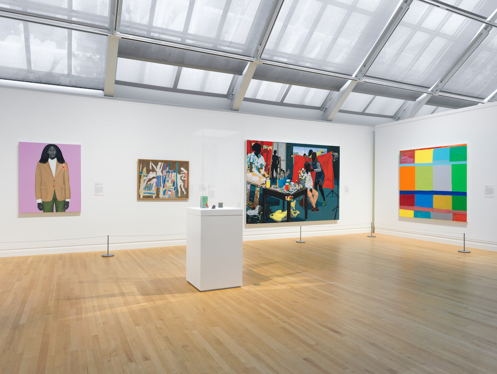 The Met's Modern and contemporary galleries. From left to right: Amy Sherald, <i>When I let go of what I am, I become what I might be (Self-imagined atlas)</i> (2018); K.G. Subramanyan, <i>Studio Table With Figure I</i> (1965); Kerry James Marshall, <i>Untitled (Studio</i> (2014); Stanley Whitney, <i>Fly the Wild</i> (2017); Center vitrine: Ron Nagle, <i>Watermelon</i> (1983); <i>Contessa</i> (1983); <i>Untitled</i> (1991). Photo courtesy of the Metropolitan Museum of Art.