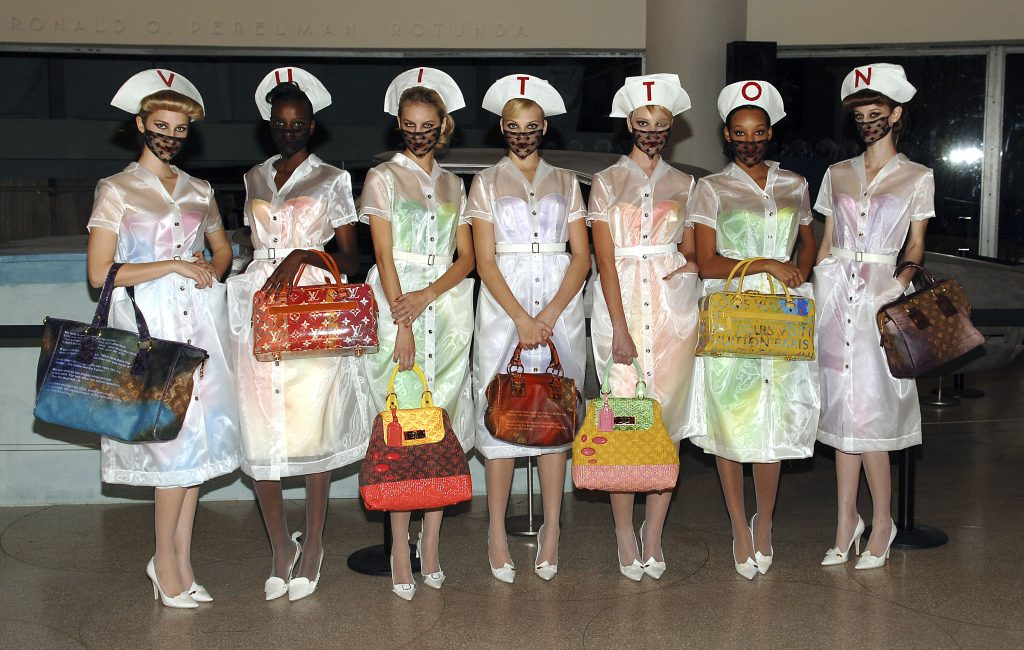 Models hold Louis Vuitton bags designed by Richard Prince at the Louis Vuitton cocktail reception celebrating the Richard Prince exhibition at the Guggenheim Museum on January 8, 2007 in New York City. Photo by Andrew H. Walker/Getty Images.