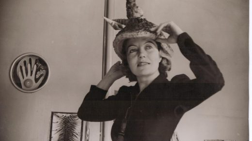 """Eileen Agar wearing a """"Ceremonial Hat for Eating Bouillabaisse."""" The picture was taken in 1936. © The estate of Eileen Agar."""