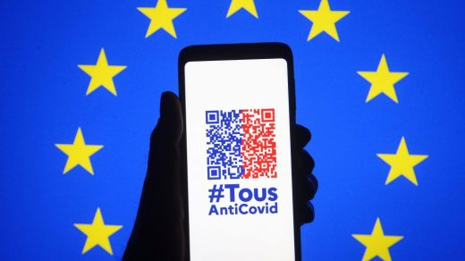 The TousAntiCovid app is seen on a smartphone with the EU flag in the background. The app's COVID-19 health pass, showing PCR tests, antigen tests, and vaccination certificates, is becoming mandatory for entrance to venues that host more than 50 people, including museums. Photo by Pavlo Gonchar/SOPA Images/LightRocket via Getty Images.