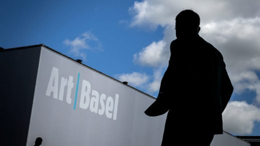 A visitor arrives at the 2019 edition of Art Basel, the last in-person version of the fair. (Photo by Fabrice Coffrini/AFP via Getty Images.)
